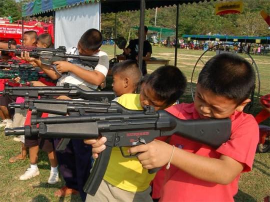 Children\'s Day in January. Kids + Guns = Cute