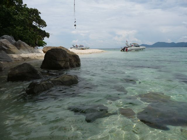 Clear Water at Koh Yuak - a few km paddle from the west coast of Koh Chang. Or take a speedboat.
