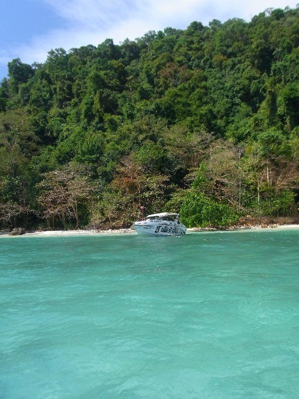 Speedboat moored off small beach