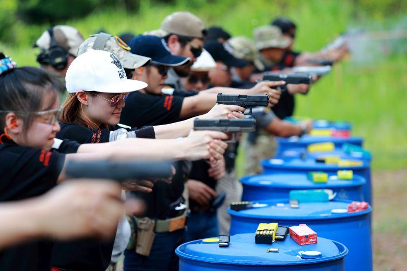 Tourists at Koh Chang Shooting Range