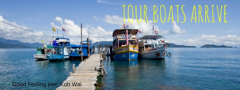 Tour boats moored at Koh Wai pier