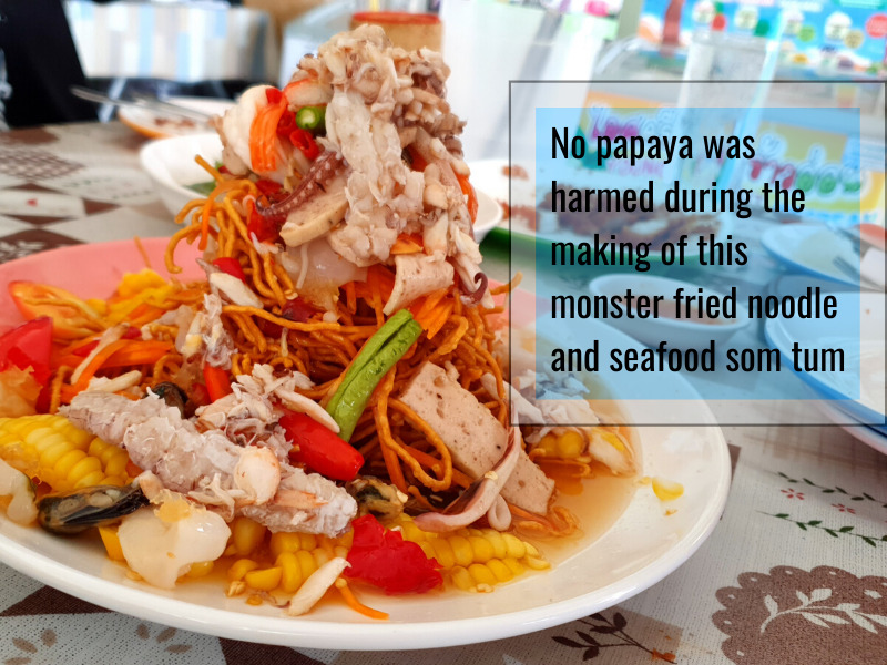 Plate of som tam fried noodle seafood