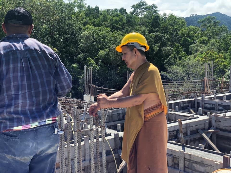Abbot supervising statue construction work