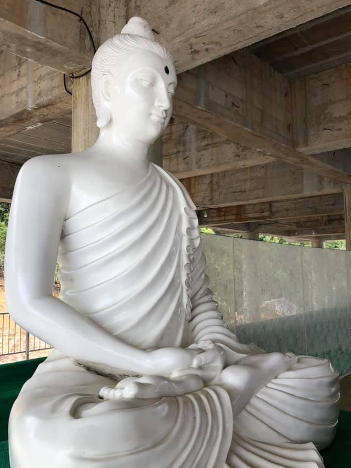 Small white buddha statue